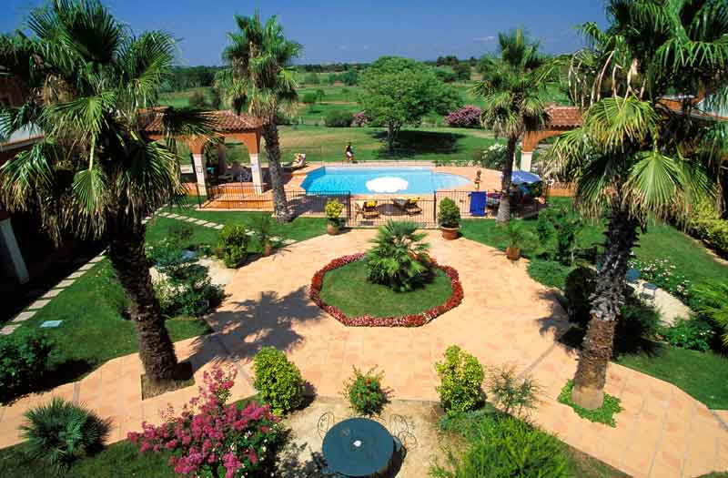 Garden and outdoor pool at the Palmyra Golf hotel in Cap d'Agde