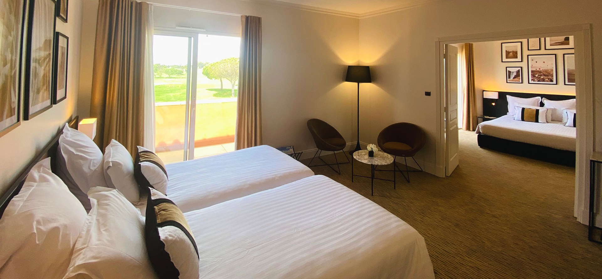 View of a suite with 1 double bed at the Palmyra Golf, a hotel with a spa in Occitanie